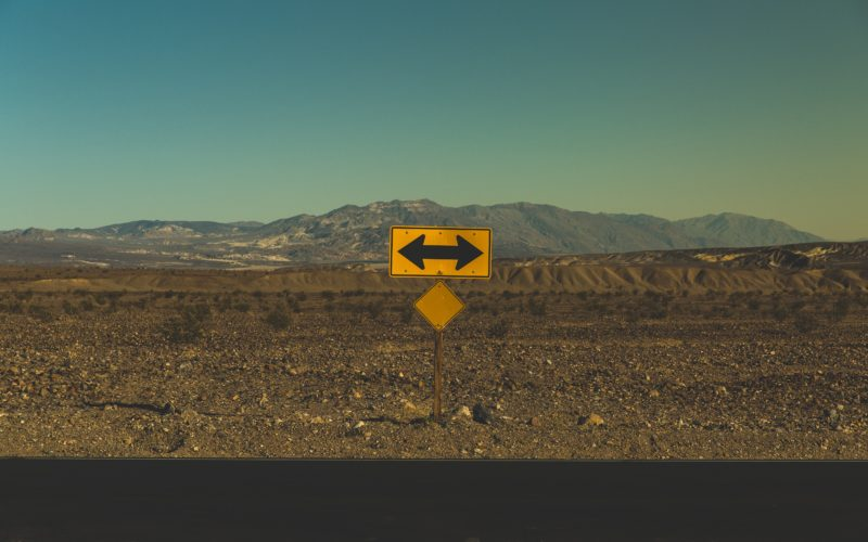 yellow arrow road sign